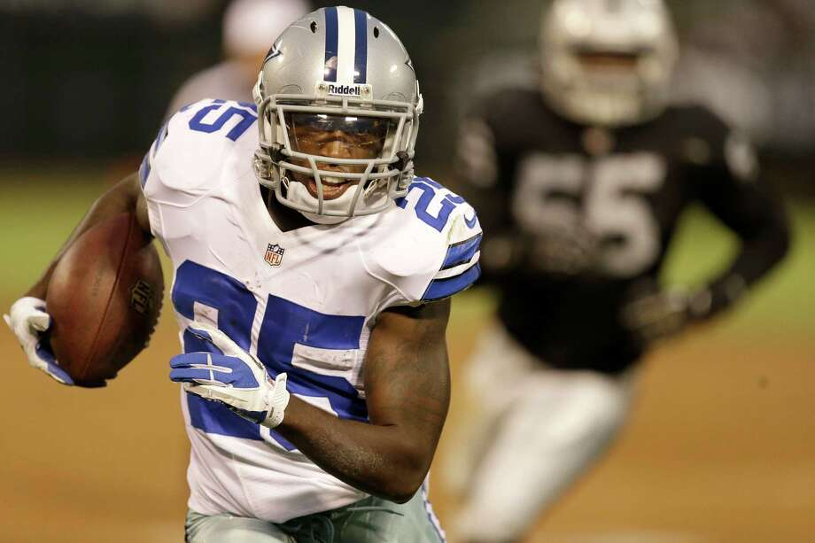 Dallas Cowboys running back Lance Dunbar (25) runs against the Oakland Raiders during the second quarter of an NFL preseason football game in Oakland, Calif., Friday, Aug. 9, 2013. (AP Photo/Ben Margot) Photo: Ben Margot, Associated Press / AP