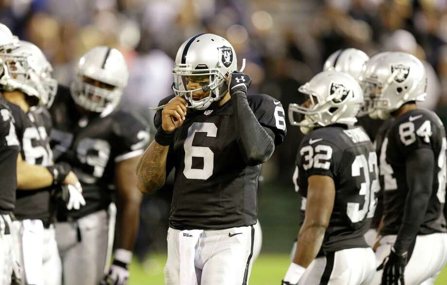Oakland Raiders quarterback Terrelle Pryor (6) stands on the field during the second quarter of an NFL preseason football game against the Dallas Cowboys in Oakland, Calif., Friday, Aug. 9, 2013. (AP Photo/Ben Margot) Photo: Ben Margot, Associated Press / AP