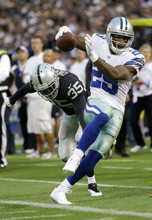 Dallas Cowboys running back DeMarco Murray (29) runs against Oakland Raiders defensive back Chimdi Chekwa (35) during the second quarter of an NFL preseason football game in Oakland, Calif., Friday, Aug. 9, 2013. (AP Photo/Marcio Jose Sanchez) Photo: Marcio Jose Sanchez, Associated Press / AP