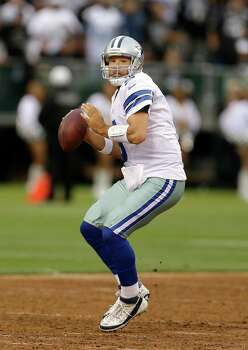 Dallas Cowboys quarterback Tony Romo (9) passes against the Oakland Raiders during the first quarter of an NFL preseason football game in Oakland, Calif., Friday, Aug. 9, 2013. (AP Photo/Ben Margot) Photo: Ben Margot, Associated Press / AP