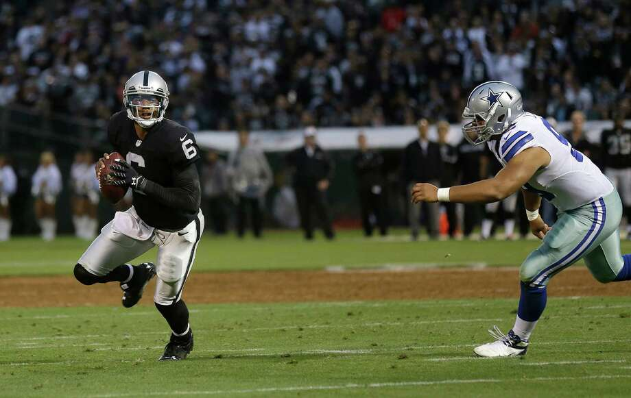 Oakland Raiders quarterback Terrelle Pryor (6) scrambles past Dallas Cowboys defensive tackle Jerome Long (99) during the second quarter of an NFL preseason football game in Oakland, Calif., Friday, Aug. 9, 2013. (AP Photo/Marcio Jose Sanchez) Photo: Marcio Jose Sanchez, Associated Press / AP