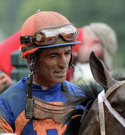 Hall of Fame jockey John Velazquez shows the mud that he picked up during his winning effort in the 29th running of The National Museum of Racing and Hall of Fame today Aug. 9, 2013, at the Saratoga Race Course in Saratoga Springs, N.Y.       (Skip Dickstein/Times Union) Photo: SKIP DICKSTEIN