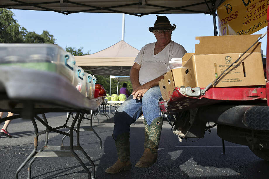 Bobby Joe Wood of Fredericksburg waits for customers during another hot August day Friday. Photo: Photos By Lisa Krantz / San Antonio Express-News