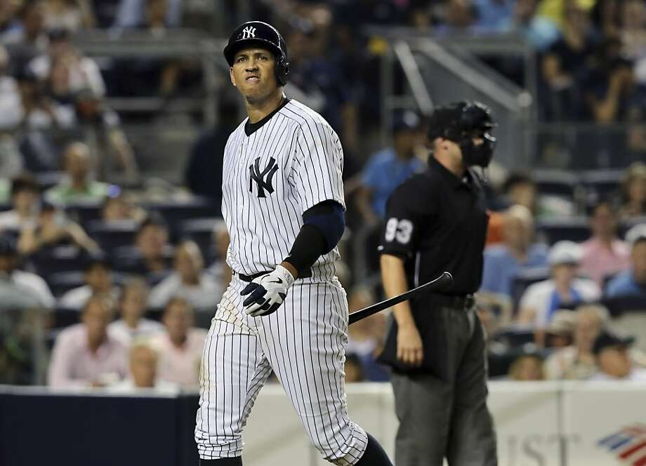 Alex Rodriguez heads to the dugout after striking out Friday night. Assuming the Yankees' infielder eventually does get suspended, might he spend some time in the Pacific Association? Photo: Richard Perry, New York Times