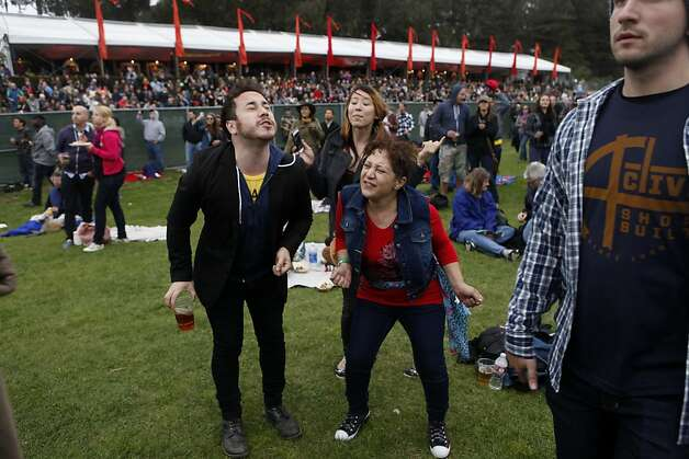 "Brian Gilmore, Akiko Thomas (back) and Ada Gilmore sing and dance to ""Eight Days a Week"" during Paul McCartney's performance on Friday. Photo: Katie Meek, The Chronicle"