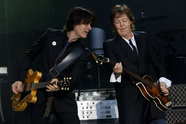 Paul McCartney, right, plays guitar with bandmate Rusty Anderson, left, on the Lands End stage during the first day of the Outside Lands music festival in Golden Gate Park in San Francisco, Calif. on August 9, 2013. Photo: Ian C. Bates, The Chronicle