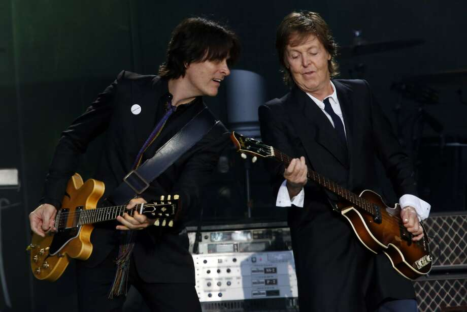 Paul McCartney, right, plays guitar with bandmate Rusty Anderson, left. Photo: Ian C. Bates, The Chronicle