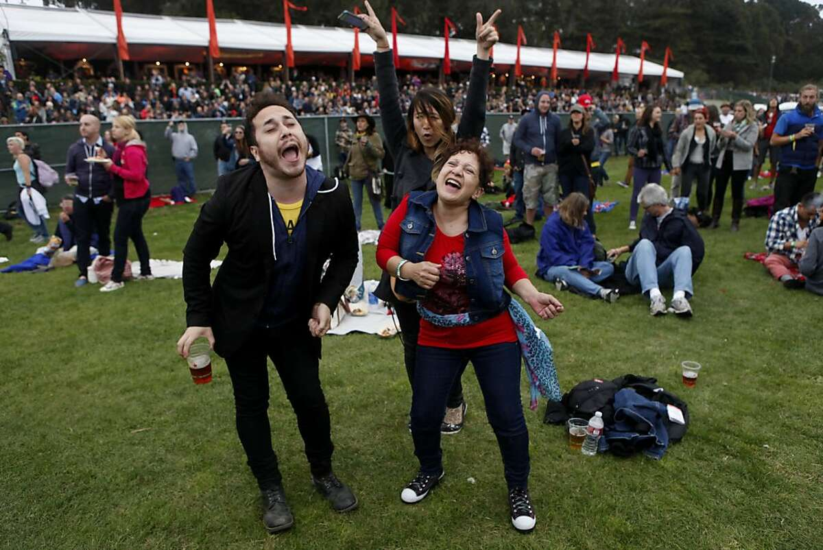 """Brian Gilmore, Akiko Thomas (back) and Ada Gilmore sing along and dance to """"Eight Days a Week"""" during Paul McCartney's performance at the Outside Lands Festival in San Francisco, Calif. on Friday, August 9, 2013."""
