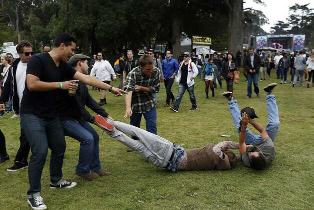 People wrestle in a middle of a crowd during the first day of the Outside Lands music festival in Golden Gate Park in San Francisco, Calif. on August 9, 2013. Photo: Ian C. Bates, The Chronicle