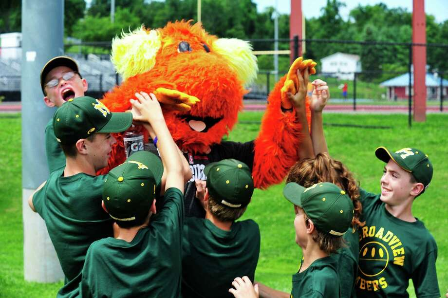 Players mob Blaze, the WNBA Connecticut Sun mascot, in a victory celebration, as their team, the Broadview Bombers beat the Danbury Bench Warmers 7 to 2, in the SLAMDiabetes Wiffle Ball Tournament in Danbury, Conn. Saturday, Aug. 10, 2013. Photo: Michael Duffy / The News-Times