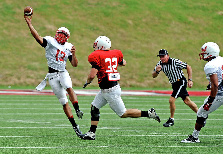 Quarterback Robert Mitchell, #13, throws on the run during the Lamar University football scrimmage o