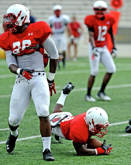 Tyrus McGlothen, #4, dives for a live ball during the Lamar University football scrimmage on Saturda