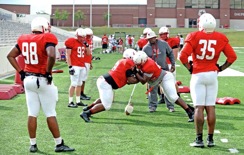 Marcu Washington, #98, and Joe Okaford, #35, look over drills before the Lamar University football s