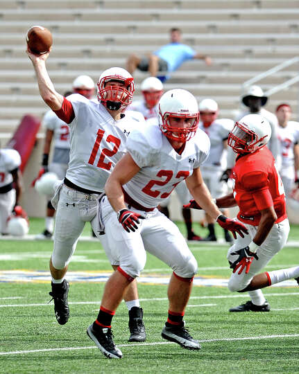 Quarterback Caleb Berry, #12, looks to pass during the Lamar University football scrimmage on Saturd