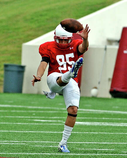 Kicker Juan Carranco, #95, punts the ball during the Lamar University football scrimmage on Saturday