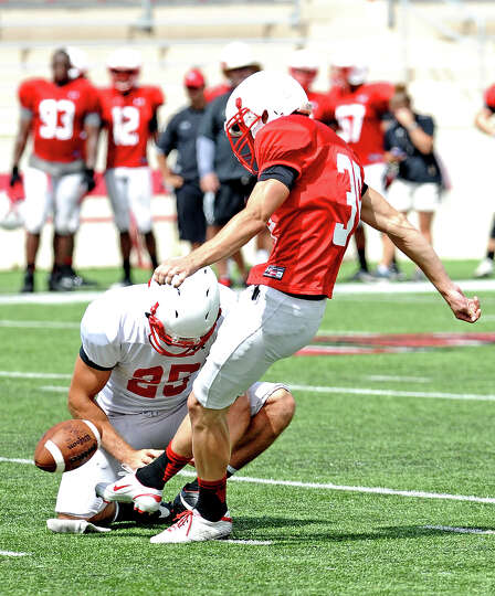 Kicker Justin Stout, #39, boots a field-goal during the Lamar University football scrimmage on Satur