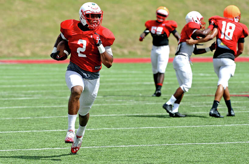 Mike Hargis, #2, finds the ball and makes a run down the field during the Lamar University football
