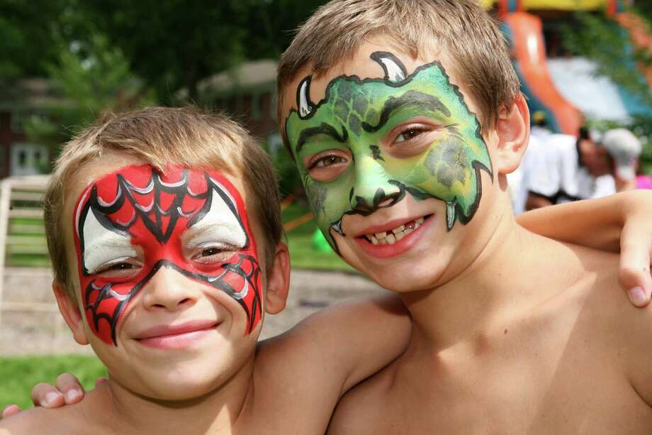 Michael Parrino, left, 6, and his brother Gary, 8, had their faces painted at the Adams Garden block party Saturday, August 10, 2013. Photo: David Ames / Greenwich Time Freelance