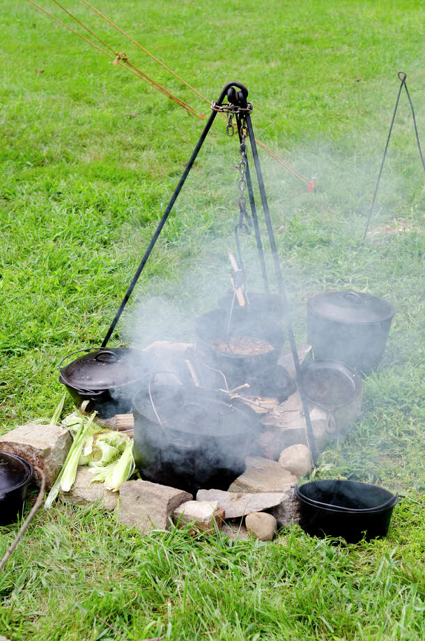 Cast iron pots of food bubble away over the fire on the grounds of Historic Bradley-Hubbell House in Easton during the 5th annual Citizens for Easton Farm Tour on Saturday, Aug. 10, 2013. Photo: Amy Mortensen / Connecticut Post Freelance