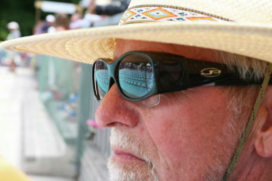 Terry Lowe keeps an eye on the action at the FCSL Swim Championships 2013 held at the Roxbury Swim & Tennis Club Saturday, August 10, 2013. Photo: David Ames / Greenwich Time Freelance
