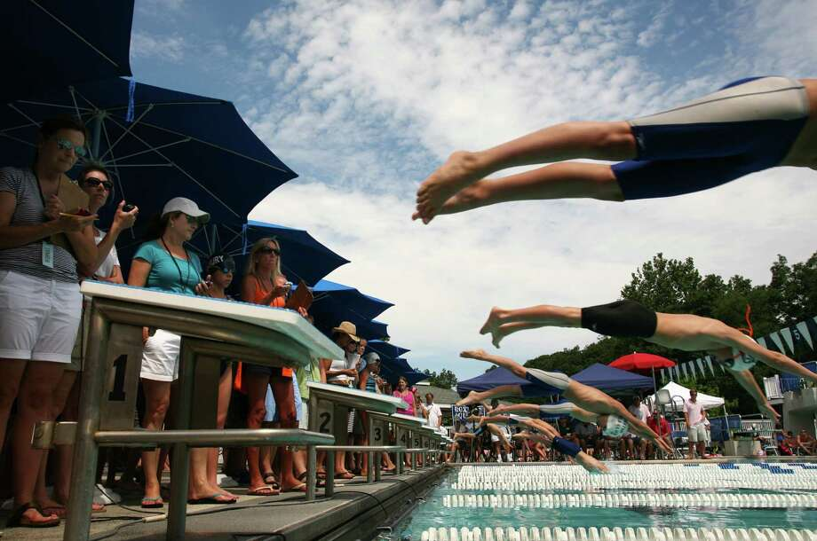 Swimmers competing in the 2013 FCSL Swim Championships leave the blocks at the Roxbury Swim & Tennis Club Saturday, August 10, 2013. Photo: David Ames / Greenwich Time Freelance