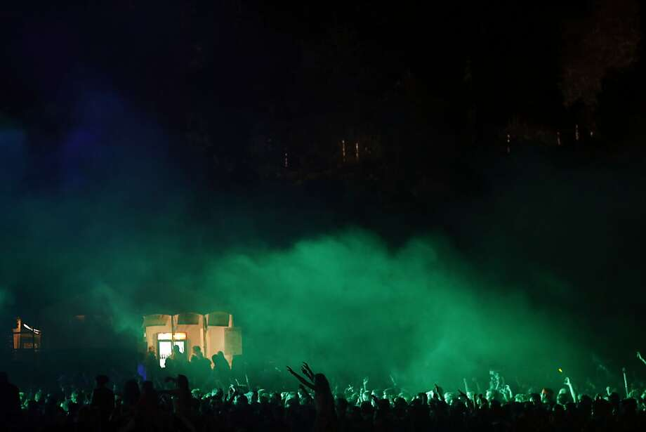 Fans puts their hands in the air during a Pretty Lights show during the first day of the Outside Lands music festival in Golden Gate Park. Photo: Ian C. Bates, The Chronicle