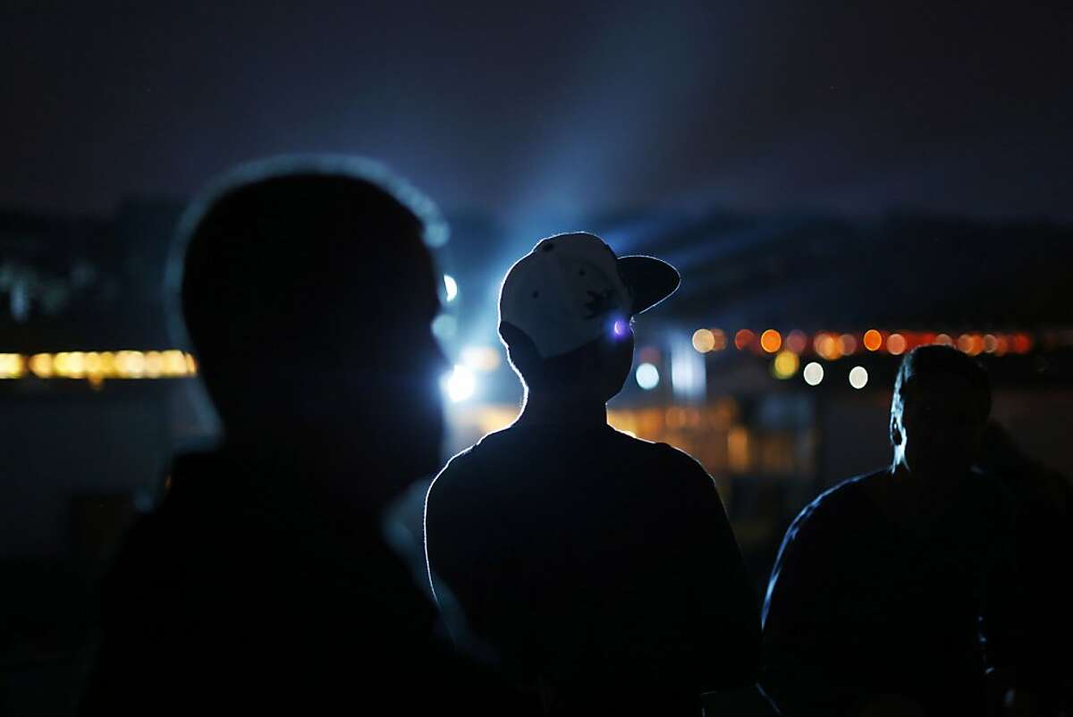 Fans watch as Paul McCartney plays his set on the Lands End stage during the first day of the Outside Lands music festival in Golden Gate Park in San Francisco, Calif. on August 9, 2013.