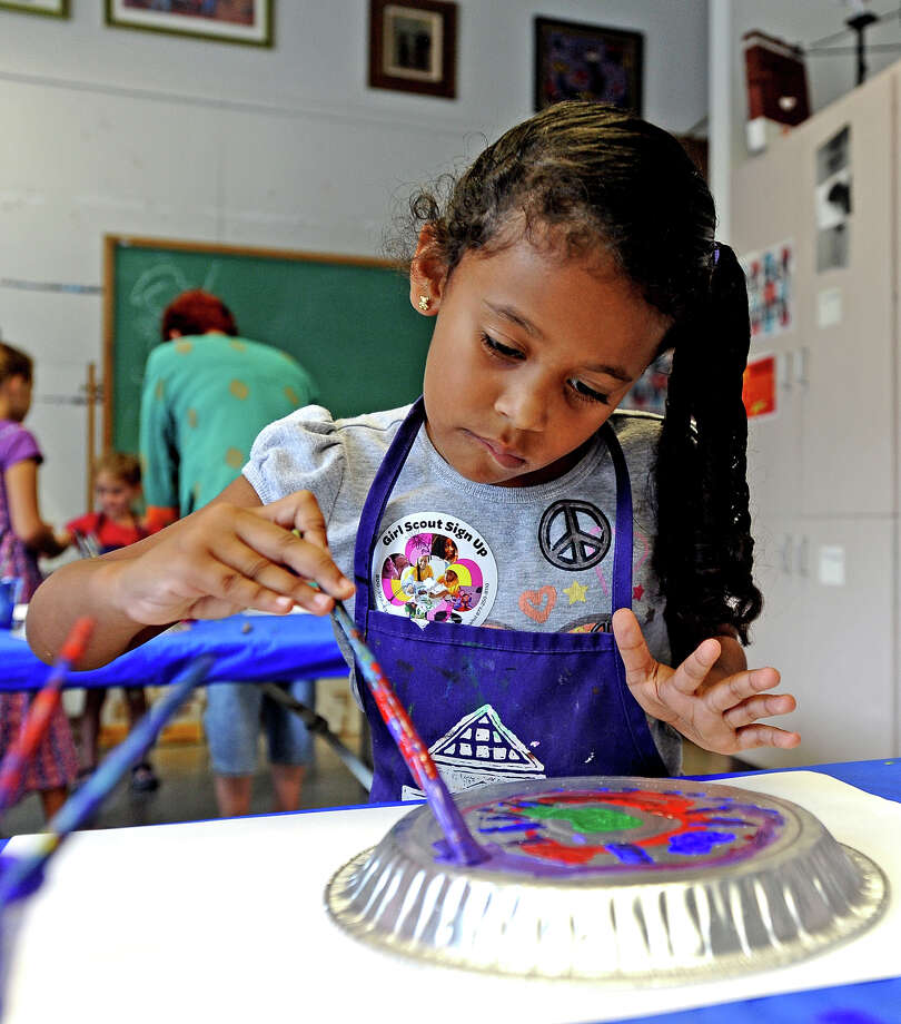 "Lucille Semien, 5, paints a pie tin during the ""Eyes Spy"" Family Arts Day at the Art Museum of Southeast Texas on Saturday, August 10, 2013. Photo taken: Randy Edwards/The Enterprise Photo: Randy Edwards, Photojournalist / Enterprise"