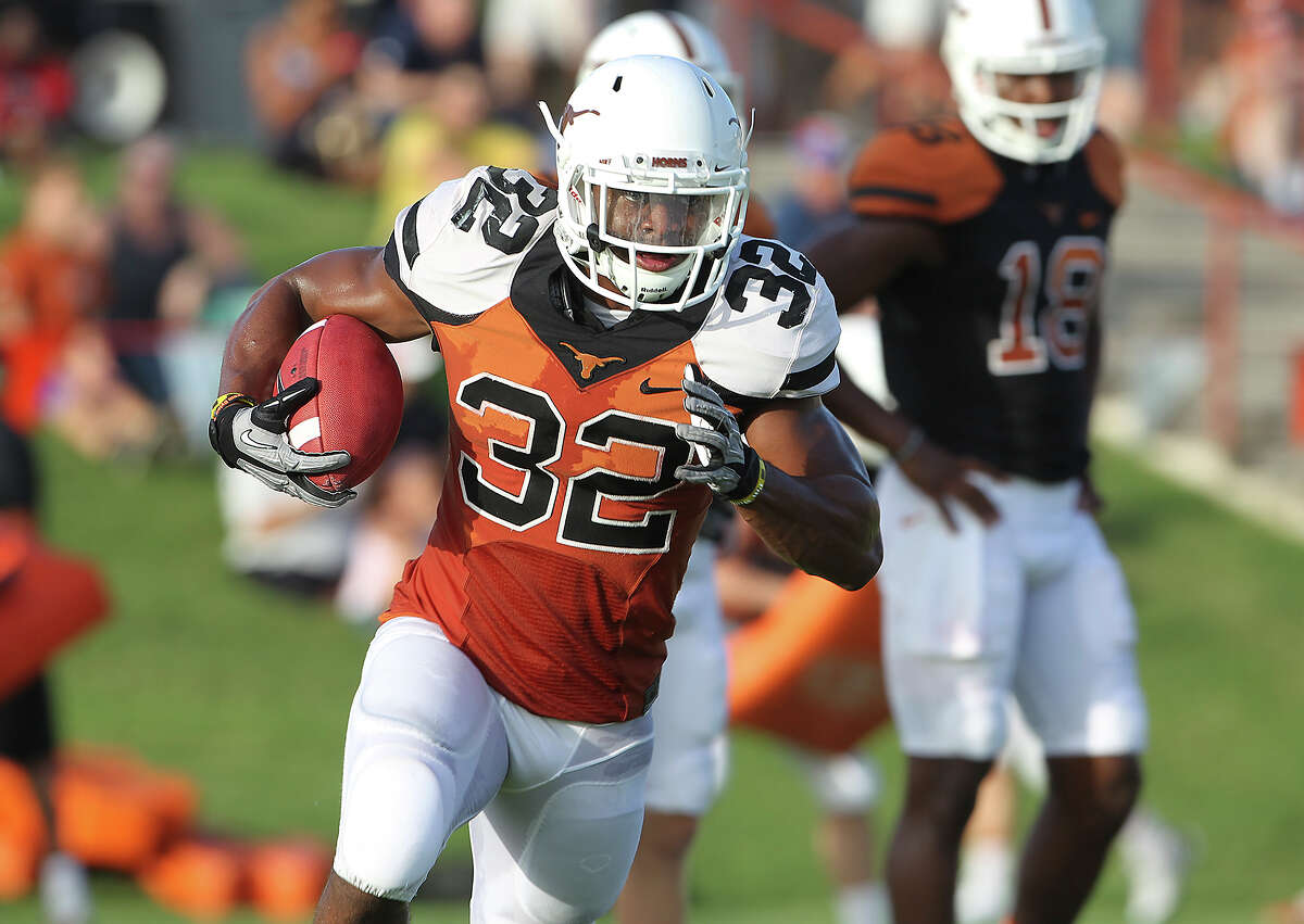 Johnathan Gray carries during UT football practice at Denius Fields in Austin on August 9, 2013.
