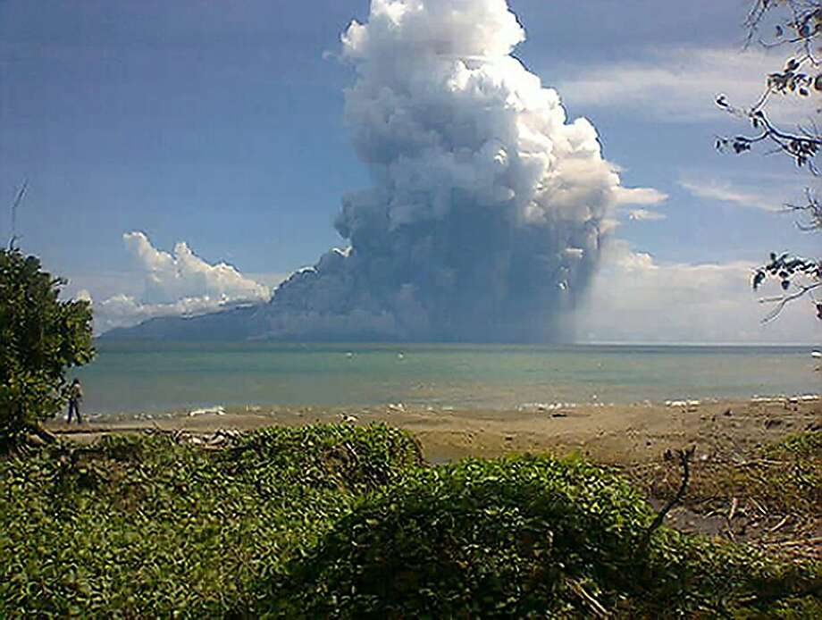 A camera-phone photo taken from the Maurole district of East Nusa Tenggara province shows Mount Rokatenda erupting on the small Indonesian island of Palue. Almost 3,000 people have been evacuated. Photo: Str, AFP/Getty Images