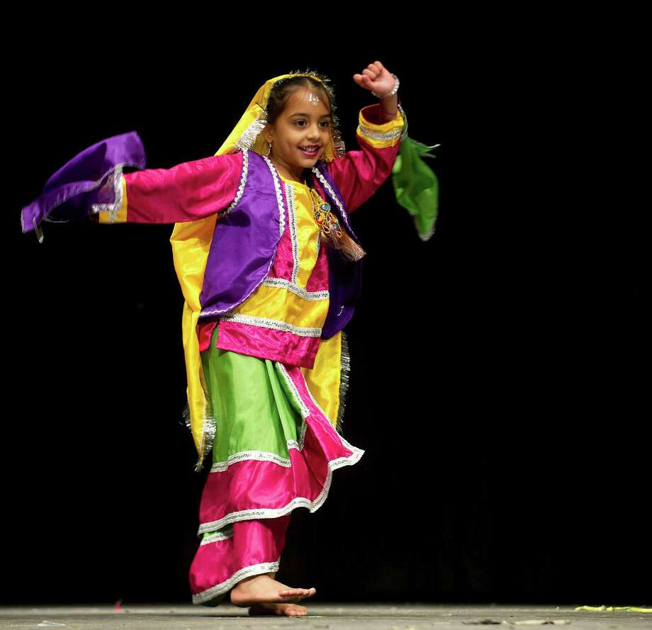 Dancers perform during an India Independence Day celebration at Westhill High School on Saturday, August 10, 2013. Photo: Lindsay Perry / Stamford Advocate