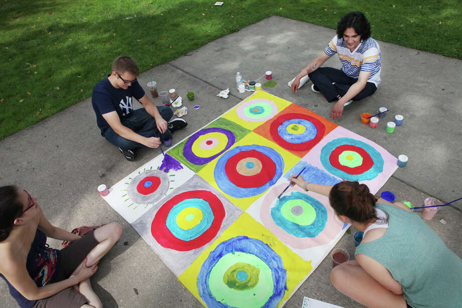 Artists, from left, Susie Picone, of East Haven, Mike Bednarsley, of Shelton, Victor Rios, of Bridgeport, and Maura Seiup, 14, create a mural during an Artist for a Day event at Sherman Green in Fairfield on Saturday, Aug. 10, 2013. World Artist Network sponsors the event which presents mini art labs for community members of all ages. Photo: BK Angeletti, B.K. Angeletti / Connecticut Post freelance B.K. Angeletti