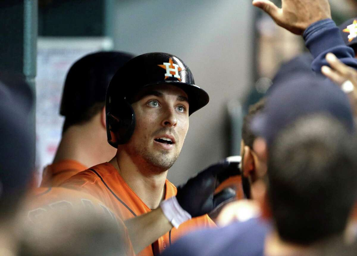 Houston Astros' Jason Castro is congratulated in the dugout after hitting a solo home run against the Texas Rangers in the second inning of a baseball game Friday, Aug. 9, 2013, in Houston. (AP Photo/Pat Sullivan)