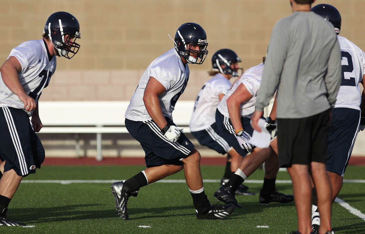 OFFENSIVE TACKLE, Cody Harris: Smithson Valley, junior - Has played in 22 games and started 20 in his career. He has shifted to left tackle.PHOTO: Harris (center) runs a drill as the Roadrunners begin fall camp at Farris Stadium on Aug. 6, 2013.
