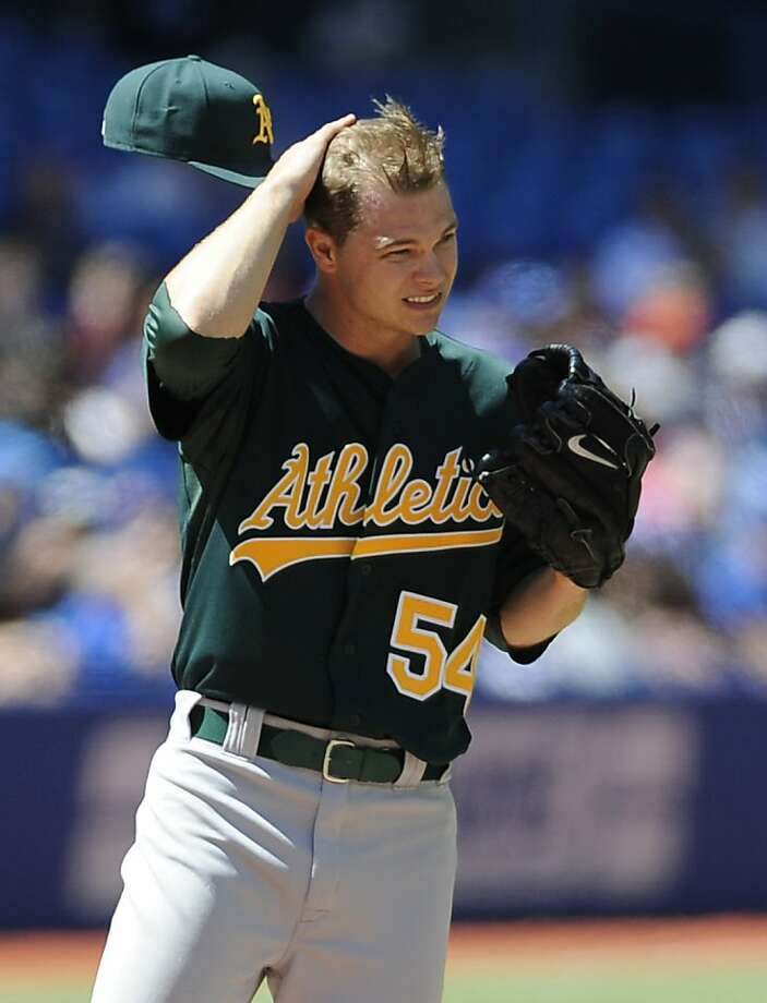 TORONTO, CANADA - AUGUST 10:  Sonny Gray #54 of the Oakland Athletics looks on during a break in MLB game action against the Toronto Blue Jays August 10, 2013 at Rogers Centre in Toronto, Ontario, Canada. (Photo by Brad White/Getty Images) Photo: Brad White, Getty Images