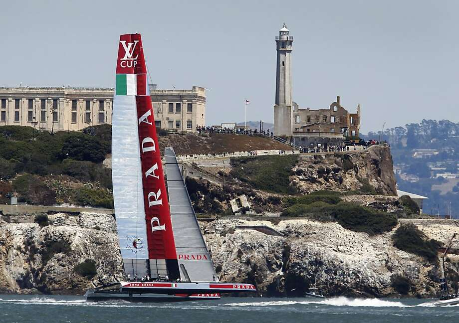 Luna Rossa's 72-foot catamaran zips past Alcatraz on its way to a fourth consecutive win over Artemis in the Louis Vuitton Cup semifinals series. Photo: Paul Chinn, The Chronicle