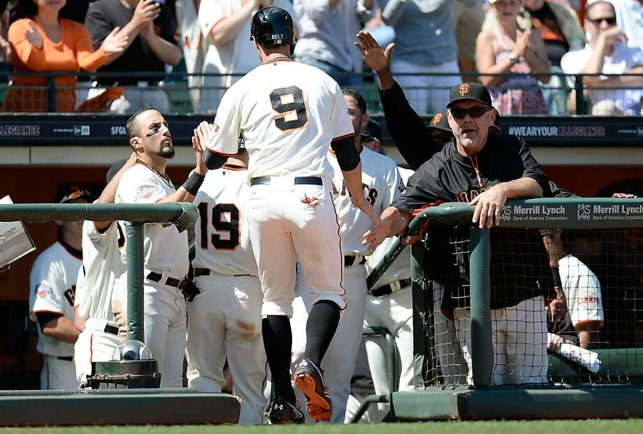 Brandon Belt gets a warm welcome from his kind, nurturing Giants teammates after coming home safely. That's baseball. Photo: Thearon W. Henderson, Getty Images