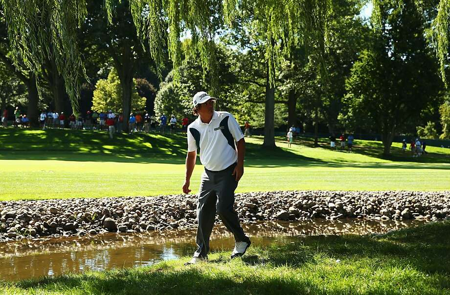 Jason Dufner, who shot a 63 on Friday, made double-bogey on No. 5 after his ball went into a creek. He is in second place. Photo: Streeter Lecka, Getty Images