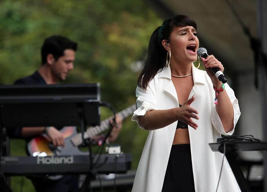 Jessie Ware performs on the Sutro stage during the 6th annual Outside Lands Music and Arts Festival in Golden Gate Park in San Francisco, Calif., on Friday, Aug. 9, 2013. The sold-out festival runs through Sunday and headliners include the Red Hot Chili Peppers and Nine Inch Nails. (AP Photo/The Tribune, Jane Tyska) Photo: Jane Tyska, Associated Press