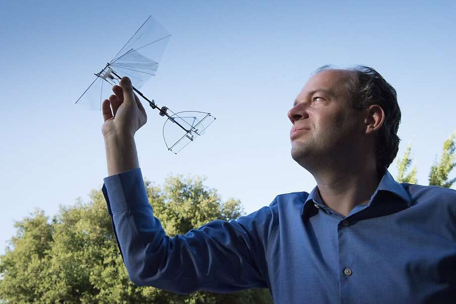 David Lentink, an aerospace engineer at Stanford, demonstrates a model of a drone he is building with his students. Photo:  Linda A. Cicero, Stanford News