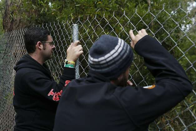 Eli Spector, left, and Joe Frankel, right, watch a band play from a hill at the Outside Land Festival in San Francisco, Calif. on Saturday, August 10, 2013. Photo: Ian C. Bates, The Chronicle