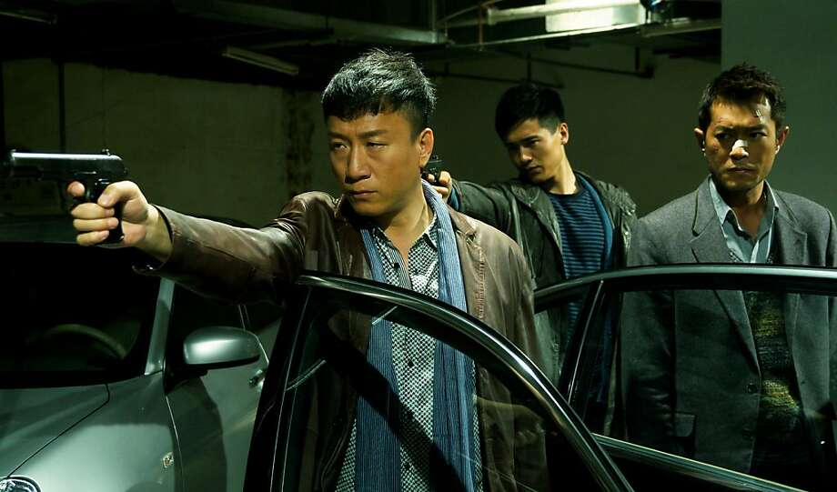 "Capt. Zhang (Sun Honglei, left) makes a point as informant Timmy Choi (Louis Koo, right) observes in Johnnie To's ""Drug War."" Photo: Well Go USA And Variance Films"
