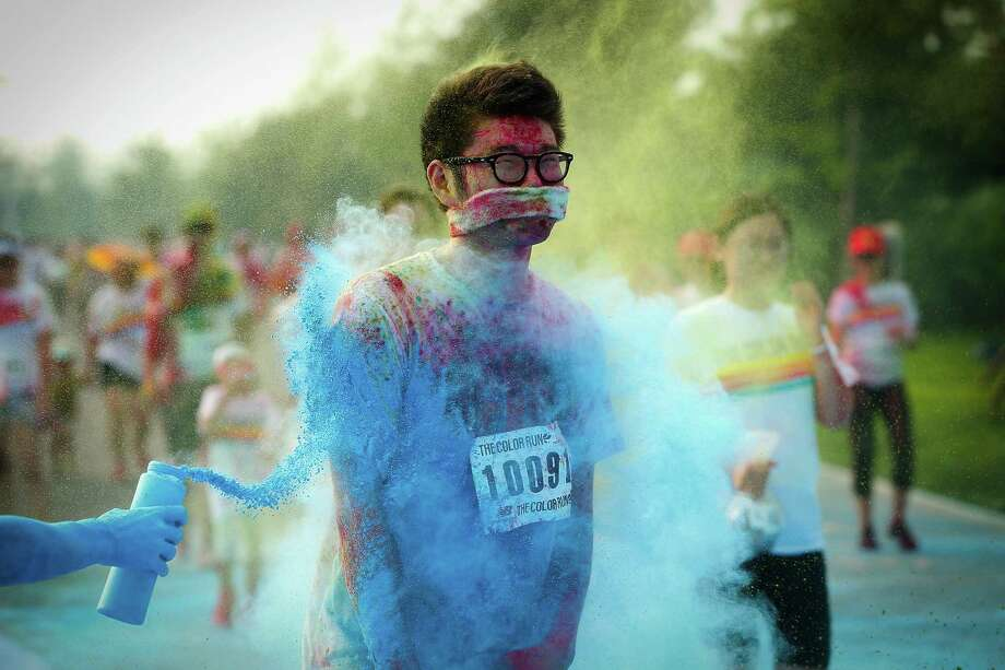 Competitors run through the blue colour station during the Colour Run at the Beijing International Garden Expo park on August 10, 2013 in Beijing, China. It's the first time China hosts this event. Photo: Lintao Zhang, Getty Images / 2013 Getty Images