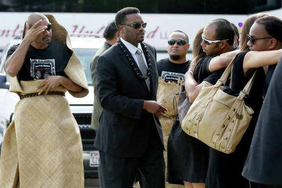 Texas A&M coach Kevin Sumlin, left, came with about 75 players and staff for the funeral of defensive lineman Polo Manukainiu, killed in a July 29 car crash.