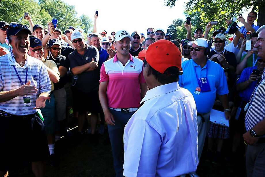 Jonas Blixt of Sweden greets Muhammad Khokhar after his tee shot on the 18th hole landed in Khokhar's pocket. Blixt got a free drop and made birdie. Photo: David Cannon, Getty Images