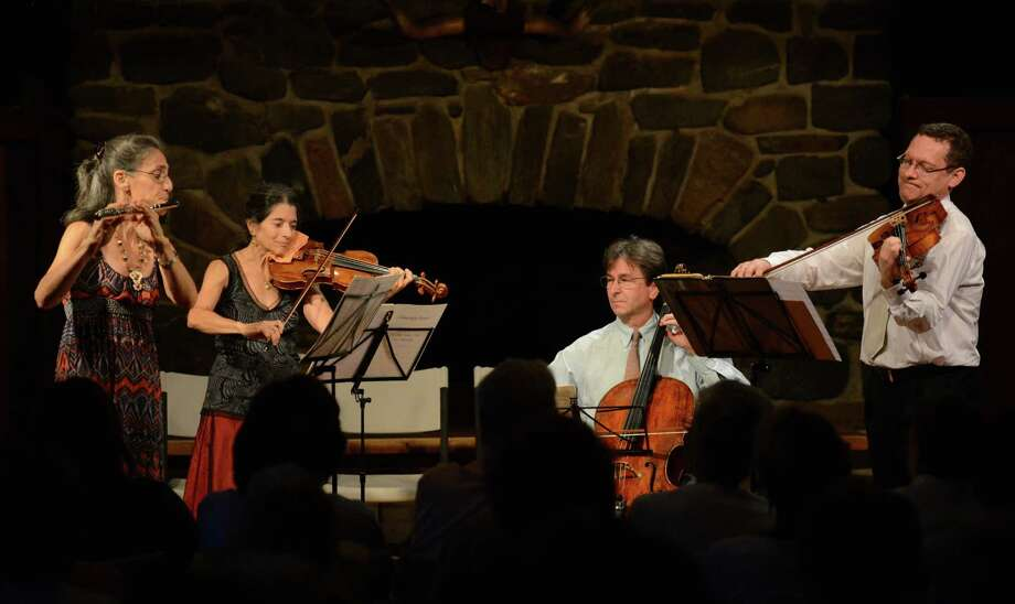 Members of the Sherman Chamber Ensemble, from left, Susan Rotholz, on flute, Jill Levy, on violin, Eliot Bailen, on cello, and Daniel Panner, on viola, perform at the Lake Mauweehoo Clubhouse in Sherman, Conn. on Saturday, Aug. 10, 2013. Photo: Tyler Sizemore / The News-Times