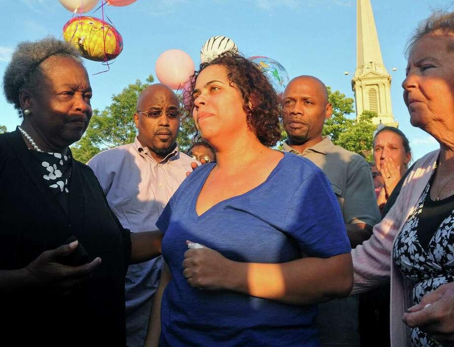 Joann Mitchell (center) attends a vigil for her children Sade Brantley, 13, and Madisyn Mitchell, 1, who are presumed to be the other two victims of the plane crash. Photo: Brad Horrigan / Hartford Courant