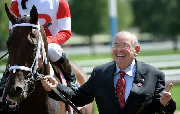 Owner Ken Ramsey is jubilant after winning the 5th race at Saratoga Race Course with Saturday Nthe Park Aug. 2, 2013, in Saratoga Springs, N.Y.  Jockey Alan Garcia was aboard for the win. (Skip Dickstein/Times Union) Photo: SKIP DICKSTEIN