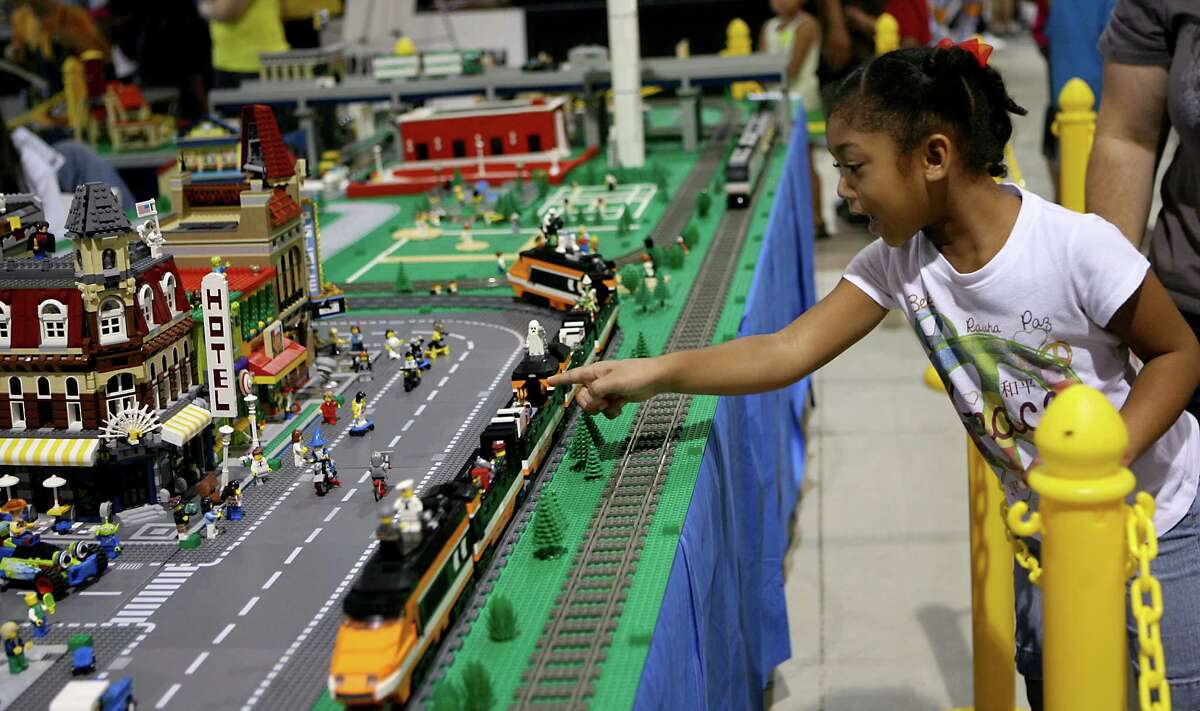 Samantha Vilanueva, 6, gets excited as she sees a train and display of LEGOs Aug. 10, 2013 at the Texas LEGO User Group's booth during the San Antonio Back 2 School Expo at the Freeman Coliseum Expo Hall. Over 50 vendors participated in the event that offered a variety of items for back to school, including toothbrushes, back packs, crayon, haircut and shots. Tex LUG said they don't give anything out, but offer a pool full and other LEGOs in front of their booth for children to play with.