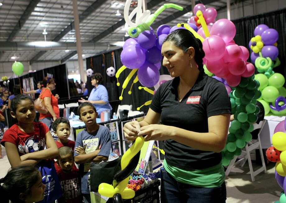 Alma Vasquez of Almapaints finishes up a baloon during the San Antonio Back 2 School Expo Aug. 10, 2013 at the Freeman Coliseum Expo Hall. Over 50 vendors participated in the event that offered a variety of  items for back to school, including toothbrushes, back packs, crayon, haircuts and shots. Photo: Cynthia Esparza, For San Antonio Express-News / For San Antonio Express-News